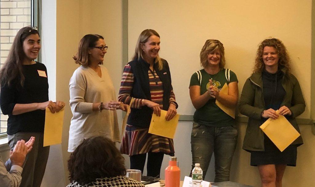 Intermediate (3-5/6) Literacy Collaborative coach, Samantha Dormady (R) receiving her certificate of completion with fellow Literacy Collaborative coaches.