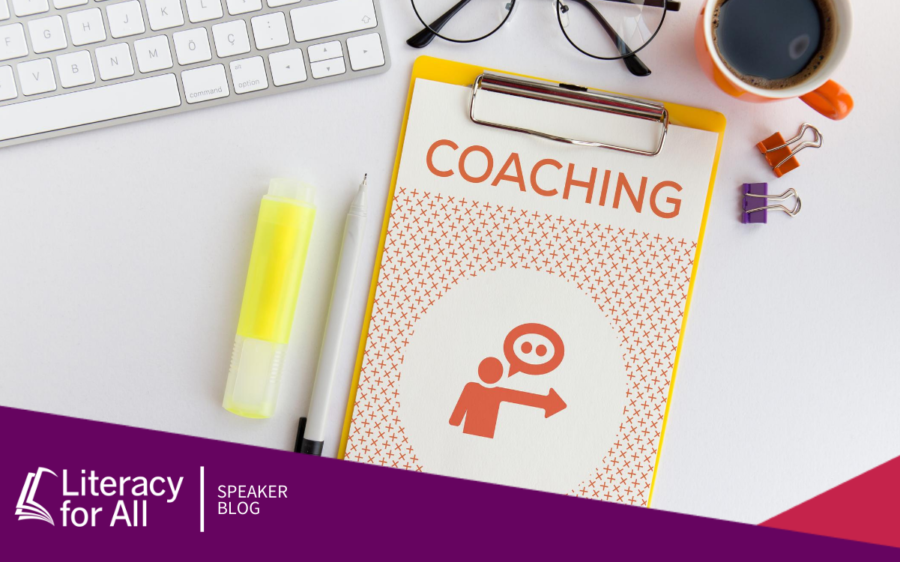 "Image of a desk with a booklet that says ""coaching"" on the cover."