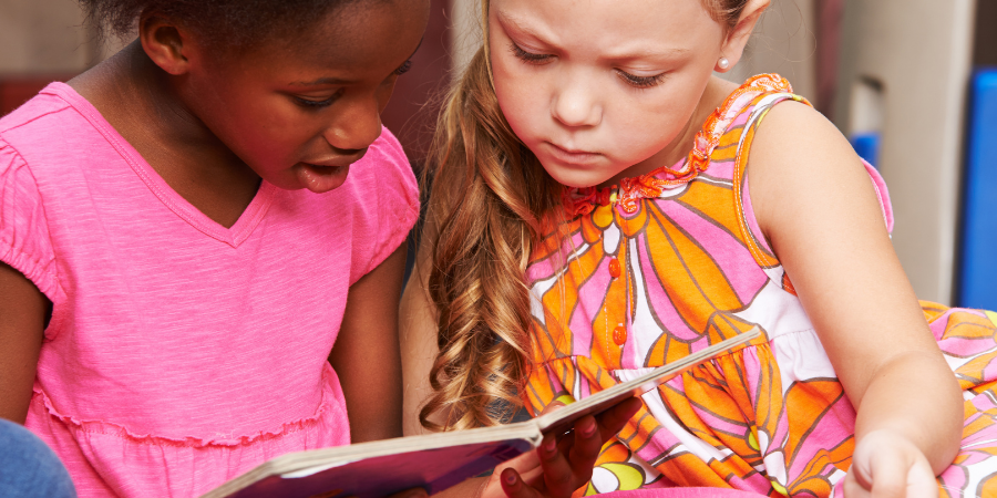 Young students reading a picture book.