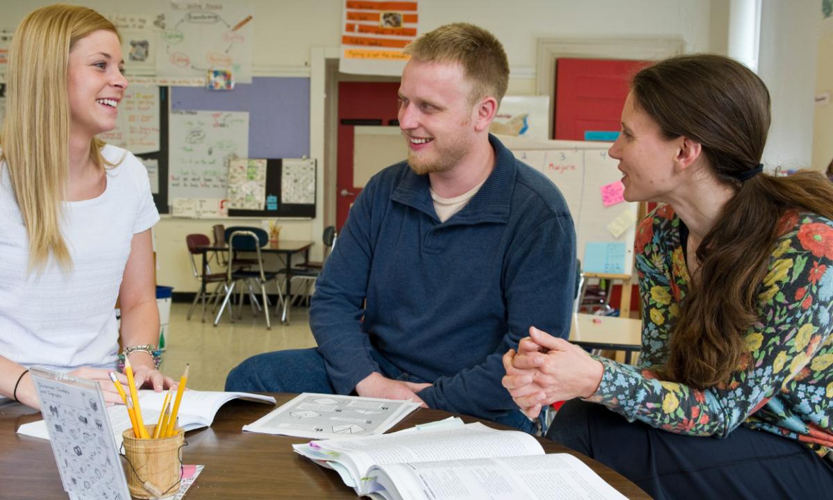 Three teachers talking.